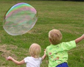 Kids Chasing Big Bubble